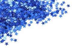 蓝色五彩纸屑星形 免版税库存图片