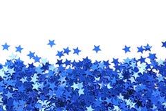蓝色五彩纸屑星形 免版税库存照片