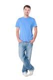 蓝色人衬衣面带笑容t年轻人 免版税库存图片