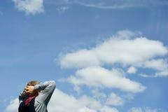 蓝色企业生意人放松天空 免版税库存照片