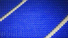 蓝色位子在西班牙体育场内 库存图片