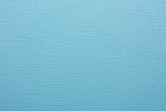 蓝色作为背景的压印的纸纹理  免版税库存照片