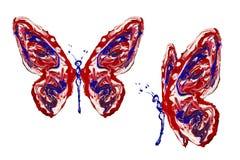 蓝色做的红色白色油漆蝴蝶集合 免版税库存照片