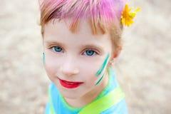 蓝色儿童眼睛面对pinted的女孩构成 免版税库存图片