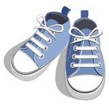 蓝色儿童运动鞋 免版税库存照片