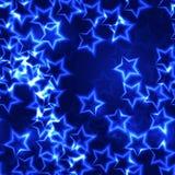蓝色光亮的星圣诞节无缝的背景 免版税库存照片