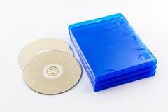 蓝色光芒圆盘箱子和蓝色光芒圆盘。 库存照片