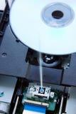 蓝色光芒盘到设备里 免版税库存图片