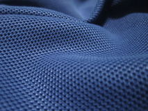 蓝色光滑的布料纹理 库存照片