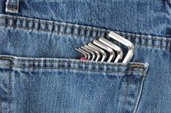 蓝色六角形的牛仔裤关键口袋板钳 免版税库存图片