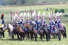 蓝色军服乘驾马的战士 免版税库存图片