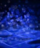 蓝色冬天雪花背景 库存图片