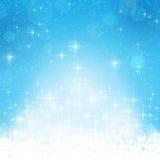 蓝色冬天,与星形的圣诞节背景 免版税库存照片