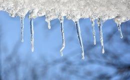 蓝色冰柱天空 库存照片