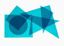 蓝色几何-在白色背景的纸几何形状 库存照片