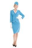 蓝色制服的迷人的空中小姐在白色背景 免版税库存照片