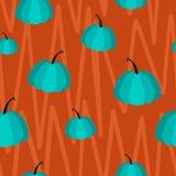 蓝色南瓜的无缝的传染媒介样式在橙色背景的 皇族释放例证