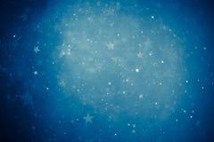 蓝色发光的星背景 免版税库存照片