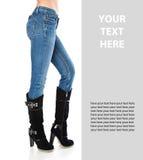 蓝色启动女性高牛仔裤行程 免版税库存照片