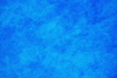 蓝色呈杂色的粒状背景 库存照片
