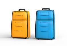 蓝色和橙色旅行行李手提箱在白色背景 免版税库存图片