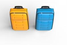 蓝色和橙色旅行行李手提箱顶视图 库存照片