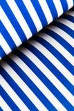 蓝色和白色有斑纹的纸 免版税库存照片