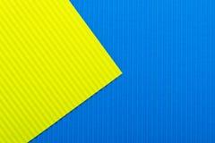 蓝色和黄色颜色纸纹理背景 趋向颜色,几何纸背景 免版税库存照片