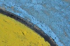 蓝色和黄色削皮油漆 图库摄影