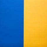 蓝色和黄色纸背景 库存照片