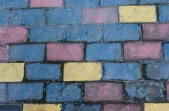 蓝色和黄色颜色,房子的墙壁一块色的砖的纹理  库存照片