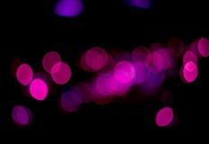 蓝色和紫色bokeh颜色摘要背景 免版税库存图片