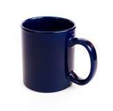 蓝色咖啡黑暗杯子 免版税库存图片