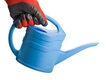 蓝色喷壶在手中 免版税库存图片