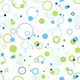 蓝色圈子加点无缝绿色的模式 免版税库存图片