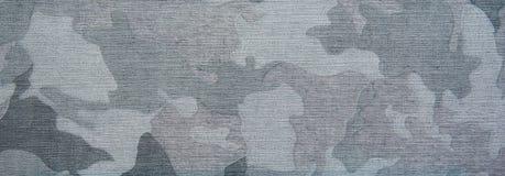 蓝色在布料的camo patern纹理 免版税库存照片