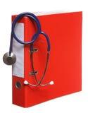 蓝色在白色查出的听诊器和红色黏合剂 免版税库存图片