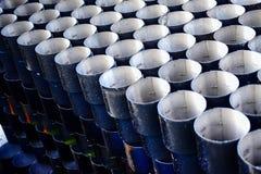蓝色在背景样式绘了金属管被堆积 免版税图库摄影