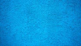 蓝色墙壁灰泥葡萄酒样式背景 被绘的表面,一个老混凝土建筑在城市 库存图片