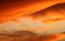 蓝色夜间桔子天空 库存照片