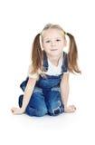 蓝色女孩牛仔裤微笑的一点 免版税库存照片
