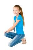 蓝色女衬衫的女孩 免版税库存照片