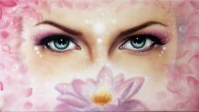 蓝色妇女眼睛放光 免版税库存照片