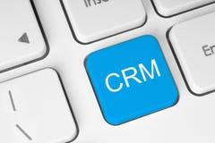 蓝色客户关系管理键盘按钮 免版税库存照片