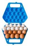 蓝色容器黑暗鸡蛋 图库摄影