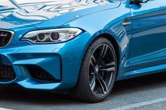 蓝色小轿车BMW M3零售在街道停放了 图库摄影