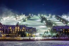 蓝色山村在冬天 免版税库存照片