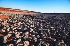 蓝色岩石天空 库存照片
