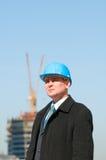 蓝色工程师安全帽 库存照片