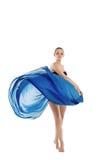 蓝色布料舞蹈飞行妇女年轻人 免版税库存照片